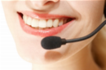 Person answering telephone with a huge smile